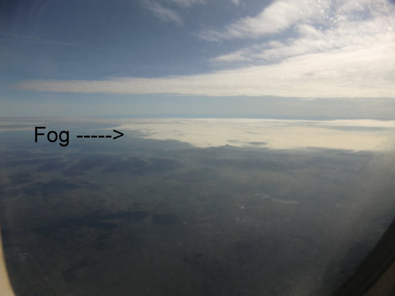 Fog rolling across the landscape above Zurich.